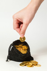 Money coins in bag and hand
