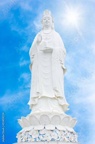 beautiful white marble guan yin with blue sky backgroung