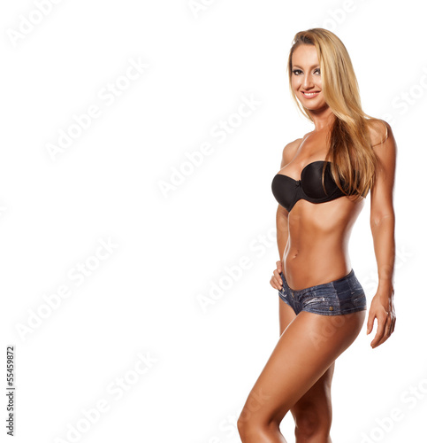 muscular girl with blond hair posing on white background