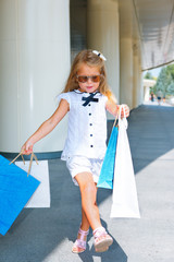 Girl walking with shopping bags