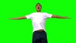 Handsome man jumping and raising arms on green screen