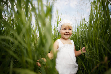 happy little girl in high grass