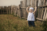 cute little girl and wooden fence