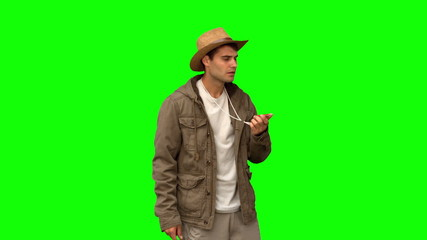 Lost man using a compass on green screen