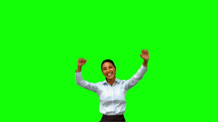 Cheerful businesswoman raising arms on green screen
