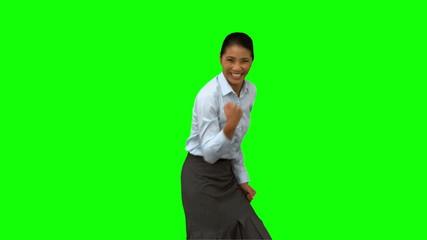 Cheerful businesswoman gesturing on green screen