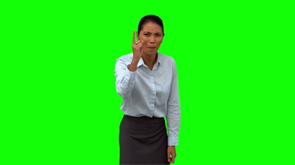 Angry businesswoman pointing on green screen