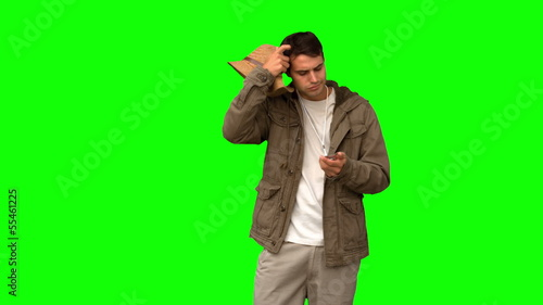 Lost man using his compass on green screen