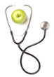 Green apple and stethoscope isolated on white background