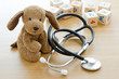 Leinwandbild Motiv Pediatrics. Puppy toy with medical equipment