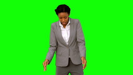 Fired businesswoman dropping a box on green screen