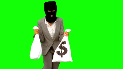 Burglar holding money bags on green screen