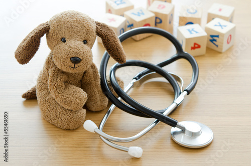 Pediatrics. Puppy toy with medical equipment - 55461650