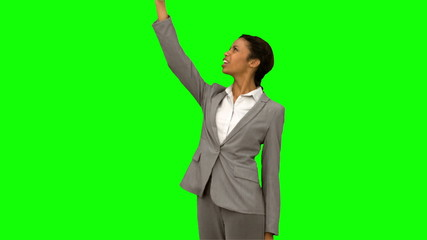 Angry woman raising her phone in the air on green screen