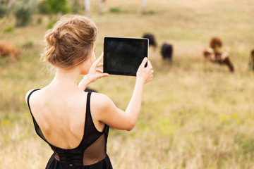 Young woman with a tablet pc