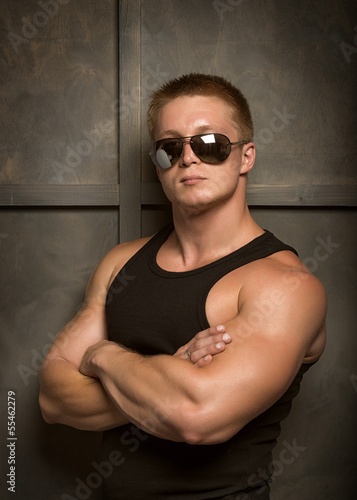 Healthy muscular young man  posing in studio