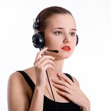 young brunette woman talking with a headset