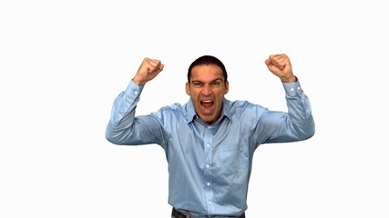 Angry businessman raising arms on green screen