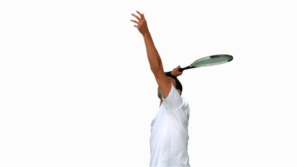 Man serving while playing tennis on white screen