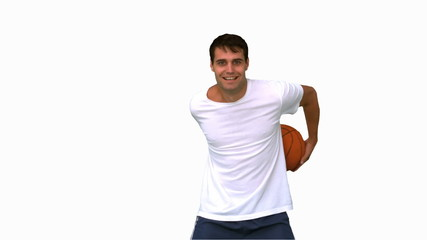 Man playing and dribbling with a basketball on white screen