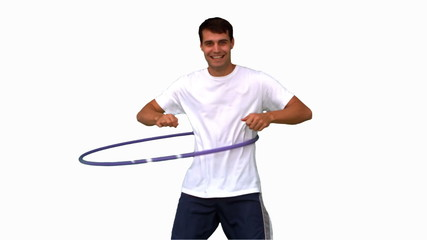 Man playing with a hula hoop on white screen