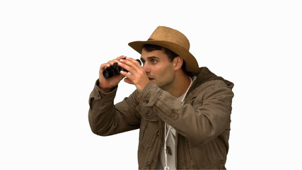 Man wearing a coat using binoculars on white screen