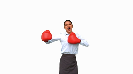 Businesswoman gesturing with boxing gloves on white screen