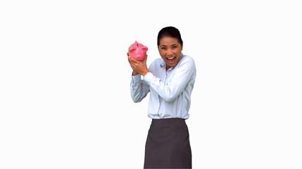 Businesswoman shaking an empty piggy bank on white screen