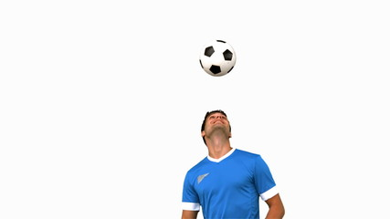 Man juggling a football with his head on white screen in slow mo