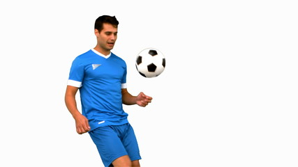 Attractive man juggling a football on white screen