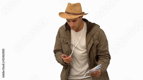 Man orienteering with a map and a compass on white screen
