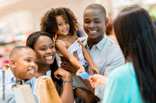 Shopping family at the cashier