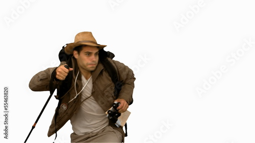 Man orienteering while holding a hiking stick on white screen
