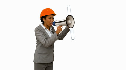 Angry architect using a megaphone on white screen in slow motion