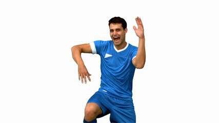 Football player celebrating a goal on white screen