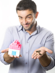 Young Man presenting Miniature House and Key