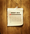 Calendar August 2014 vintage paper on wood background