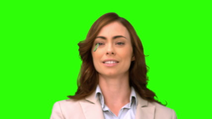 Businesswoman throwing a coin on green screen