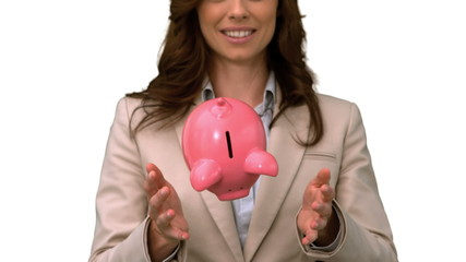 Businesswoman throwing a piggy bank on white screen