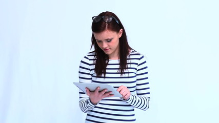 Beautiful trendy woman using her tablet