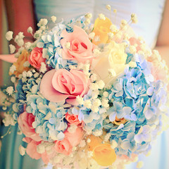 Bride or bridemaid with bouquet, closeup with retro filter effec
