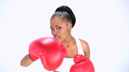 Smiling model wearing red gloves boxing