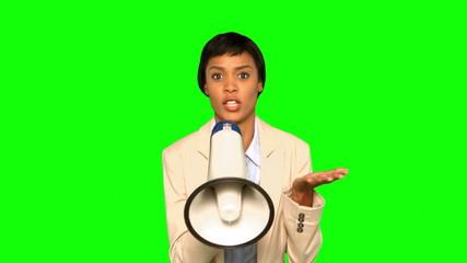 Serious businesswoman talking on megaphone