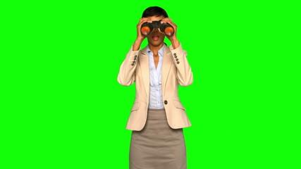 Astonished businesswoman using binoculars