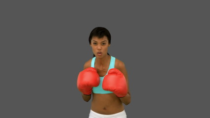 Gorgeous woman with red gloves boxing
