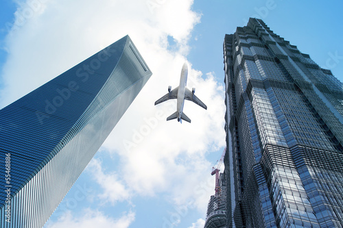 Modern buildings with airplane.