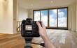 Leinwanddruck Bild - Man photographing empty living room with digital camera