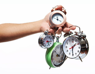 Hand with alarm clock.