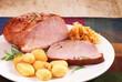 Pork loin on white plate