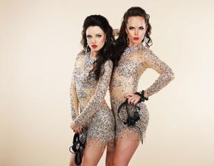 Amusement. Two Showgirls with Headphones - Nightlife